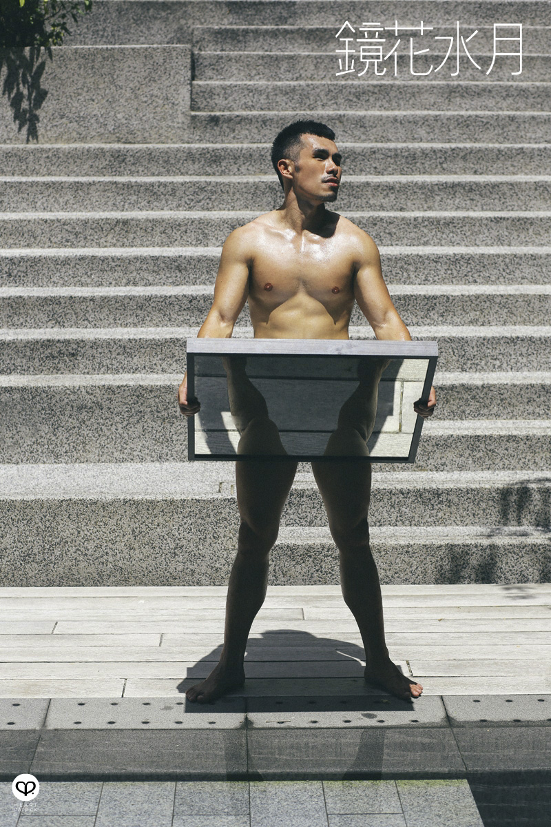 asian male creative portrait with mirror and trunks